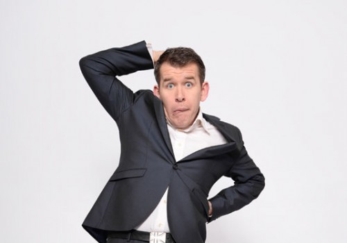 ian jones in comedic pose wearing a blue suit